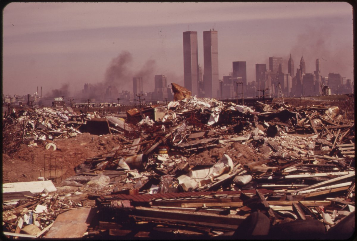 the-agency-helps-regulate-cleanups-in-particularly-polluted-sites-the-twin-towers-are-visible-behind-the-trash-heap-in-this-image.jpg